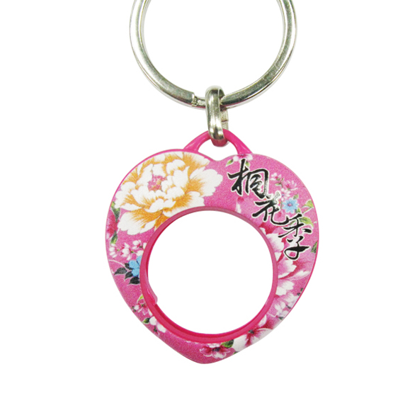 Heart shaped Coin Keyring with hollow which can put a one euro coin.